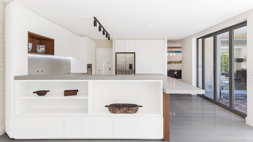 Dover Heights Kitchen, Polyurethane and Likewood Timber Grain kitchen with a sleek concrete Caesarstone bench.