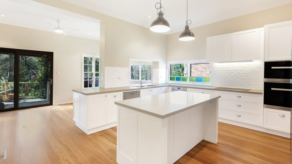 AFTER Epping Renovation, Satin Polyurethane Shaker Style Doors with a Caesarstone benchtop in Shitake