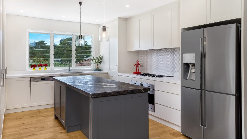 AFTER Greenwich Renovation, Shaker Style kitchen in a polyurethane finish with a Cosmic Black Granite benchtop