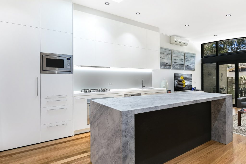 AFTER Lilyfield Renovation, Polyurethane kitchen with Super White Granite in a honed finish