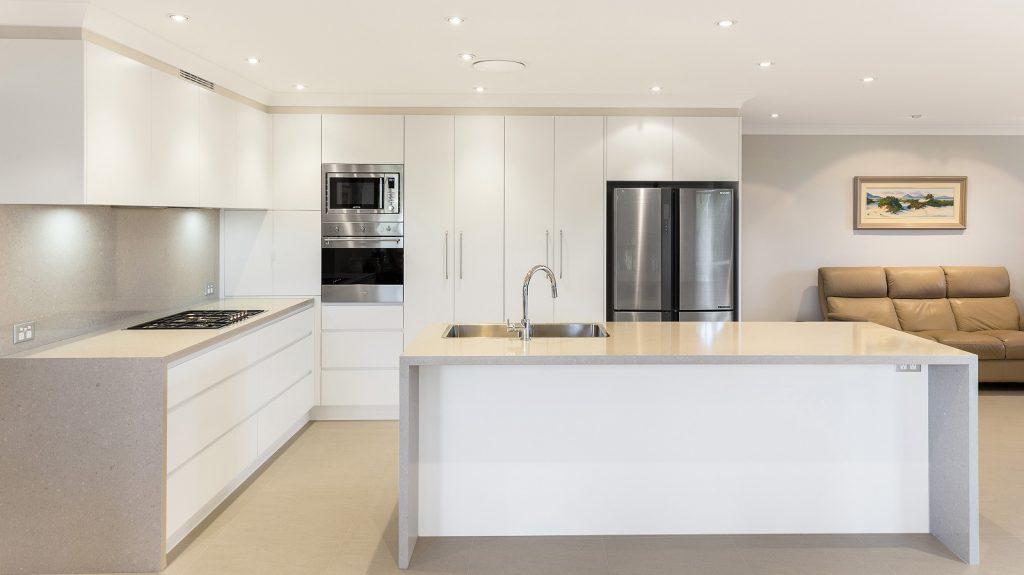 AFTER Menai Renovation, Satin Polyurethane kitchen with a Quantum Quartz benchtop