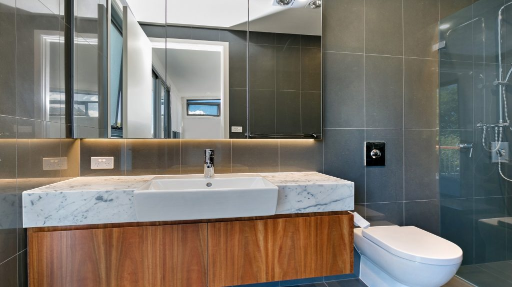 Timber Veneer vanity with a Carrara Marble top and mirror cabinets above - Annandale, Sydney