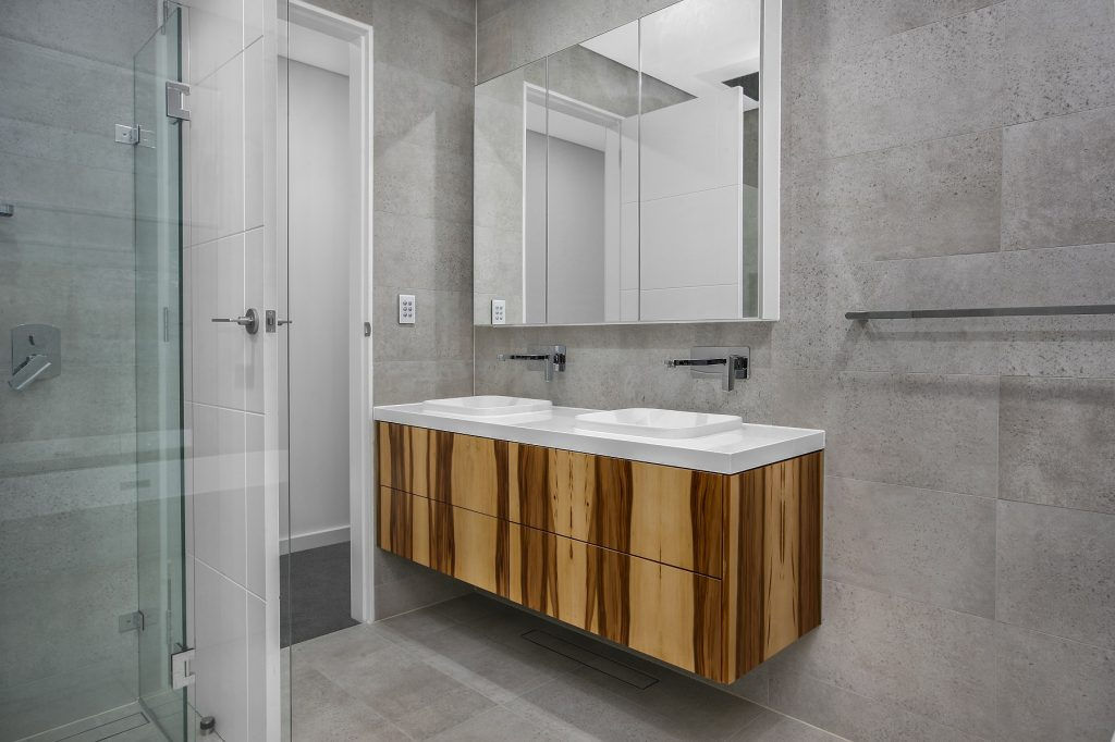 Timber Veneer vanity with a Caesarstone top and mirror cabinets above - Chipping Norton, Sydney