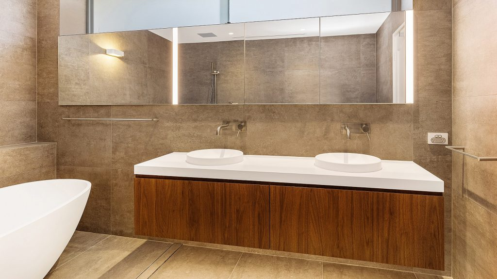 Likewood vanity with a Caesarstone top and mirror cabinets above - Dover Heights, Sydney