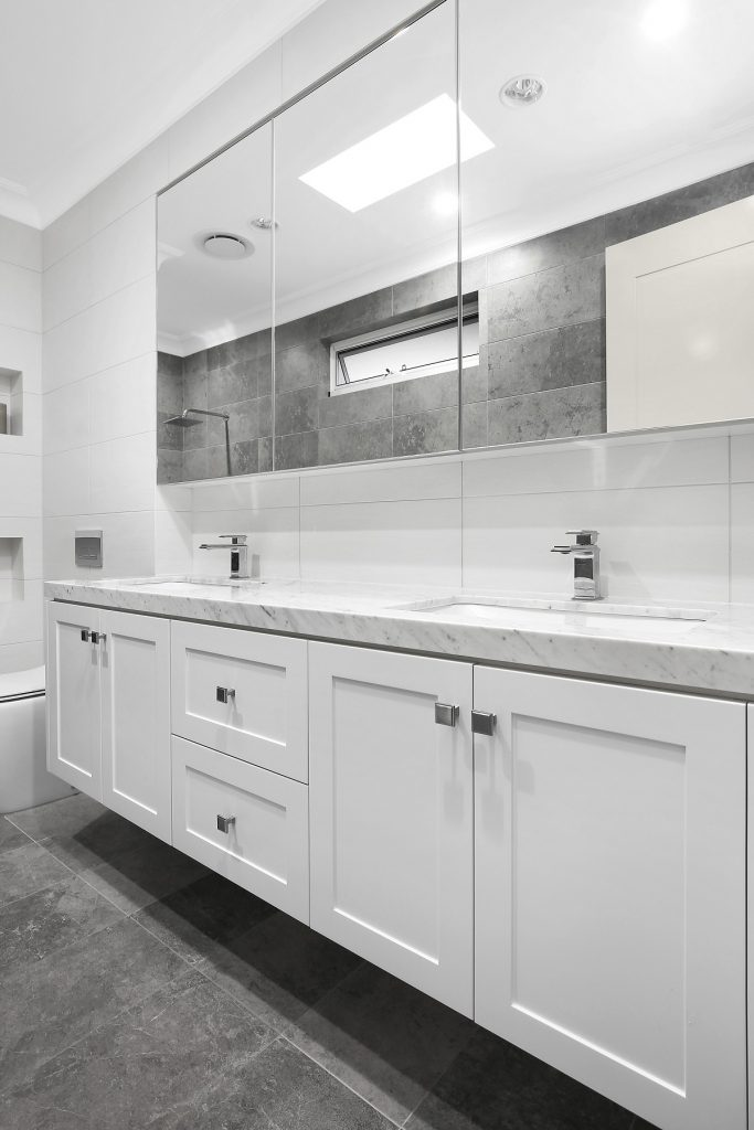 Shaker style vanity with a Caesarstone top and mirror cabinets above - Earlwood, Sydney