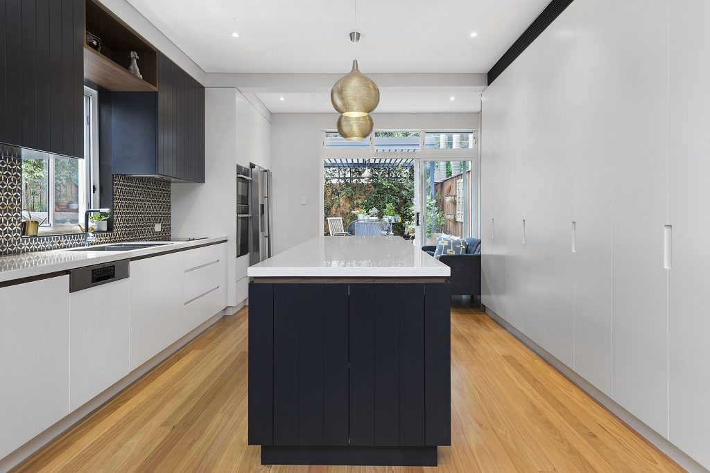 AFTER North Bondi Renovation, Two-tone Polyurethane kitchen with V-Groove panels and integrated handles