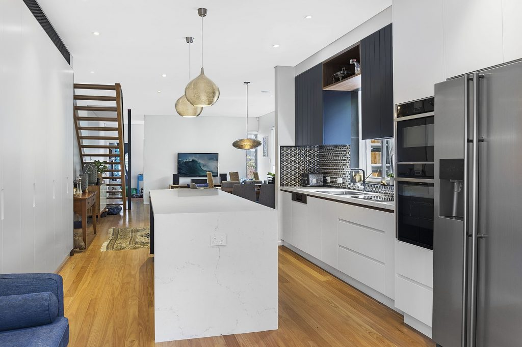 North Bondi, Two-tone Polyurethane kitchen with V-Groove panels and integrated handles