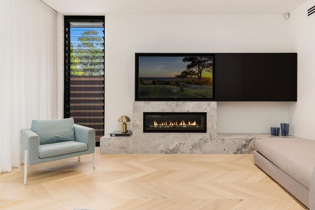 Fireplace with stone feature and Veneer push open AV cupboards - Concord, Sydney