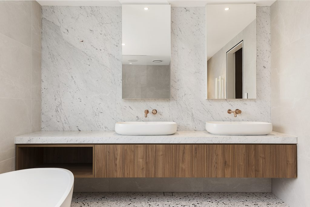 Polytec Woodmatt double vanity with a Carrara Marble top and splashback with mirror cabinets - Concord, Sydney