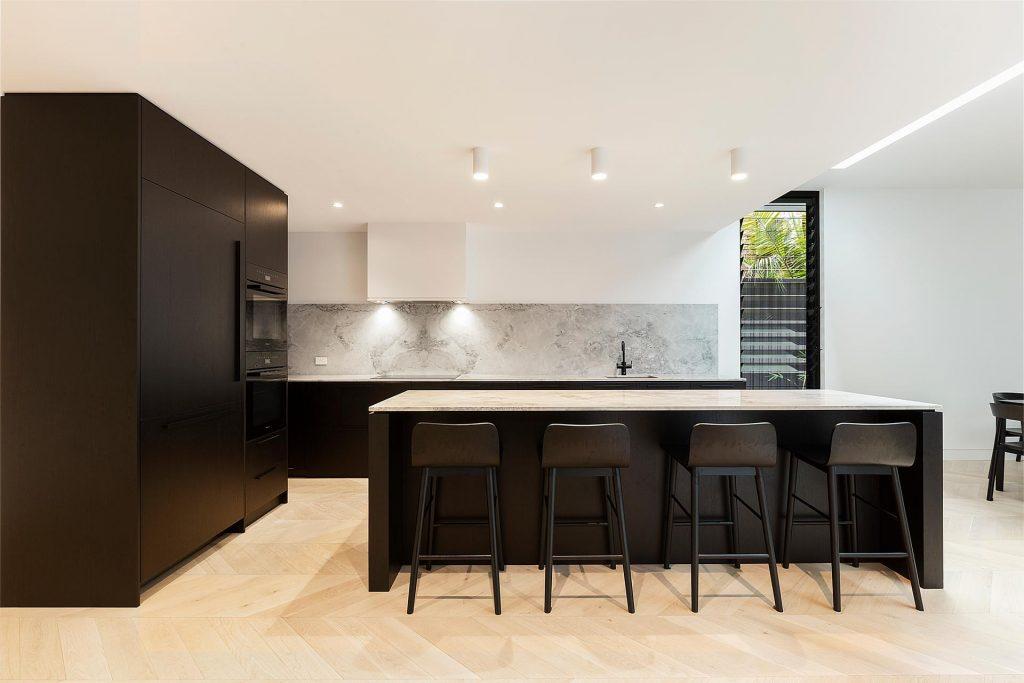 Veneer kitchen featuring a Super White Stone island bench and splashback - Concord, Sydney
