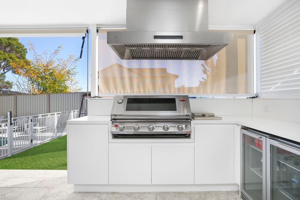 Polyurethane Outdoor BBQ area with V-groove doors and Caesarstone bench - Georges Hall, Sydney