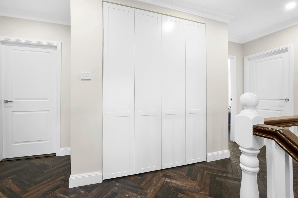 Shaker Style linen closet with push open doors - Georges Hall, Sydney