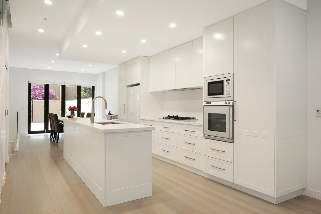 AFTER Lilyfield Renovation, Polyurethane Shaker Style kitchen with an island bench and Michelangelo stone tops