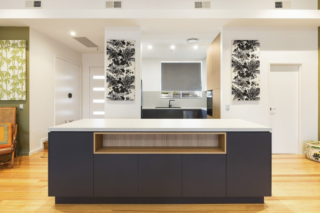 AFTER Lilyfield Renovation, Laminate kitchen with push open doors and an island bench with a Smartstone top in Pelle Grigio