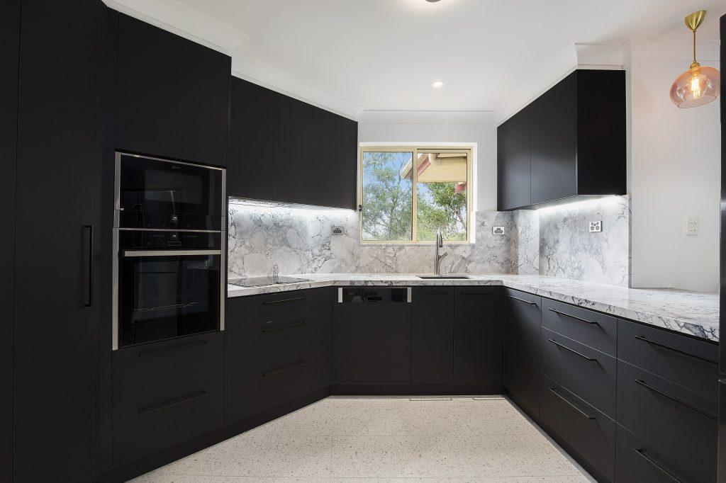 AFTER Miranda Renovation - Venette kitchen in Polytec Black with a 40mm Super White stone benchtop and splashback