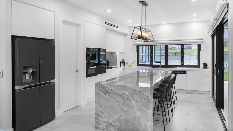 Modern Satin Polyurethane kitchen with electronic push open drawers and a feature island in Super White granite - Twin Creeks, Sydney