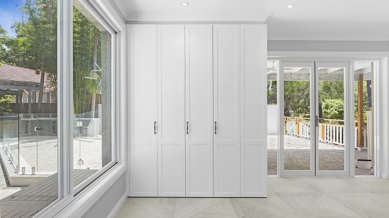 Polyurethane Shaker style cabinets with bi-folding doors to laundry area - Oatley, Sydney