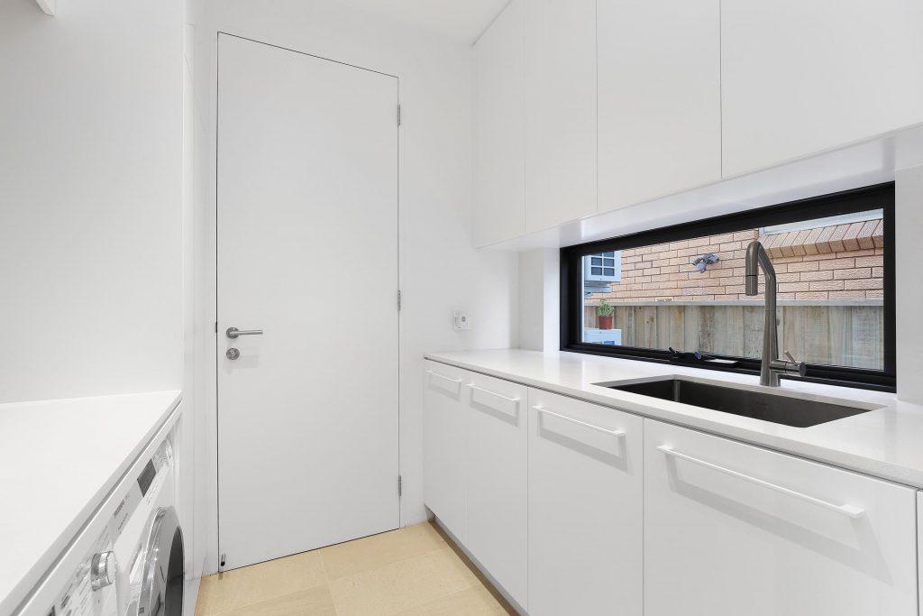 Polyurethane laundry with 20mm stone benchtops - Putney, Sydney