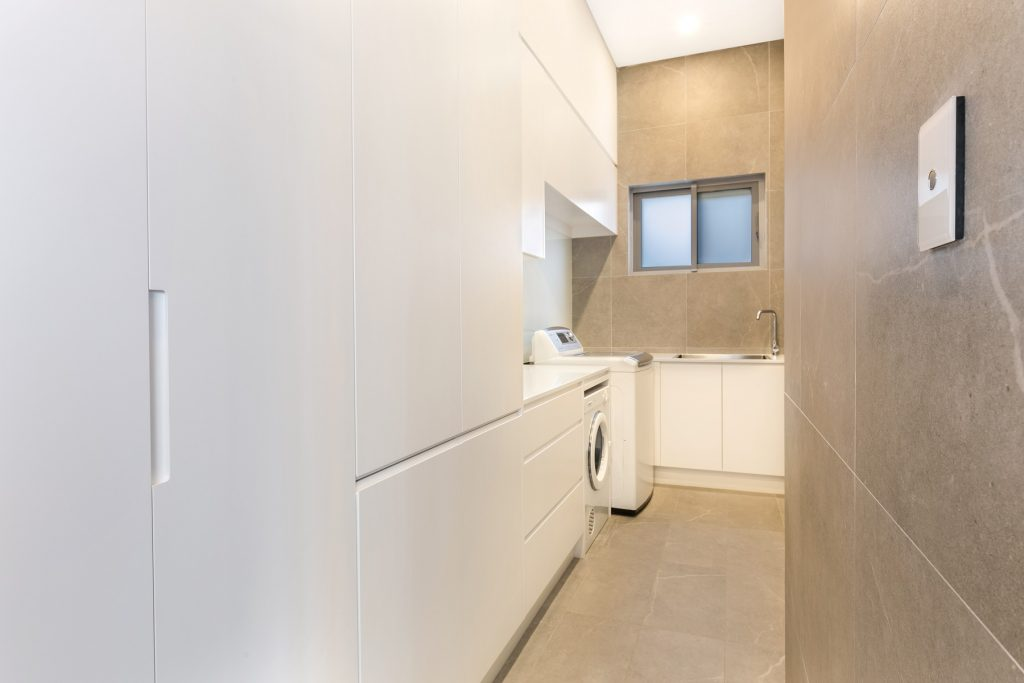 Polyurethane laundry with integrated handles - Guildford, Sydney