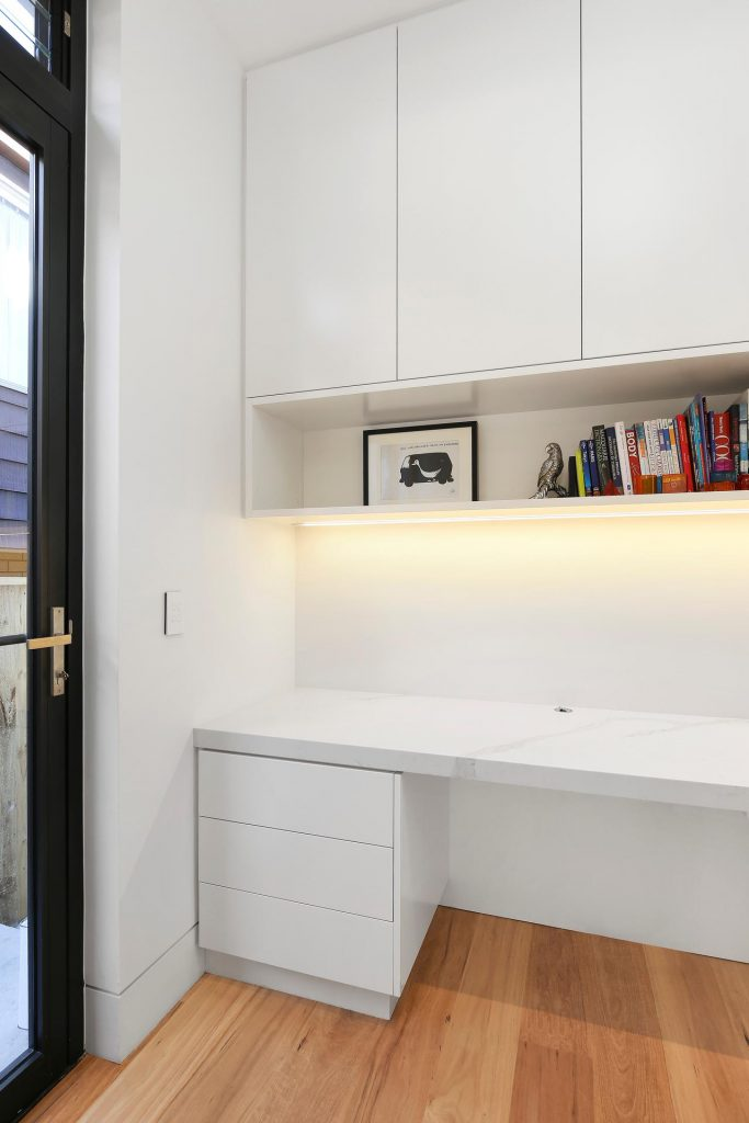 Polyurethane study desk with a stone benchtop and open shelving - Putney, Sydney