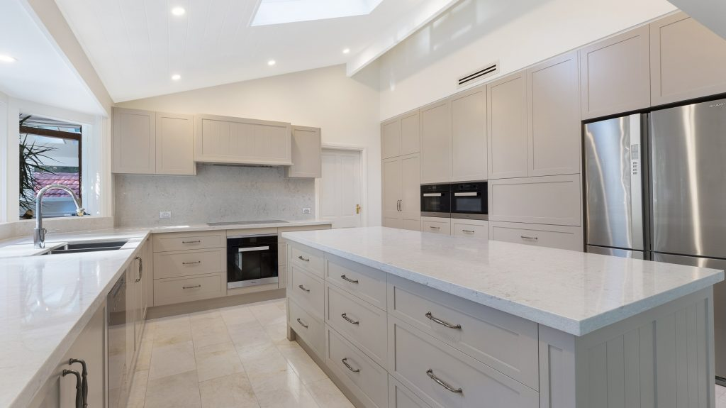 Satin Polyurethane Shaker Style kitchen with V-Groove feature panels and a Caesarstone benchtop - Wahroonga, Sydney
