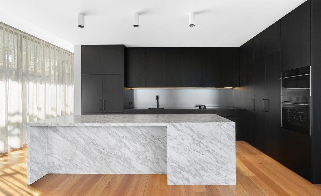 Veneer Polyurethane kitchen featuring a Carrara Marble Island bench with waterfall return - Putney, Sydney